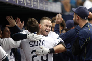 Evan Longoria #3 of the Tampa Bay Rays hugs teammate Steven Souza Jr. #20 in the dugout as they celebrate Longoria's two-run home run against the New York Yankees on May 28 in St. Petersburg, Florida. The Tampa bay won 9-5.