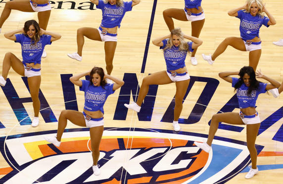 Oklahoma City Thunder cheerleaders perform during a break in the action in game six of the Western Conference Finals between the Oklahoma City Thunder and the Golden State Warriors during the 2016 NBA Playoffs at Chesapeake Energy Arena on May 28 in Oklahoma City.