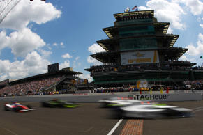 The field races over the yard of bricks during the 100th running of the Indianapolis 500 at Indianapolis Motorspeedway on May 29, 2016 in Indianapolis, Indiana.
