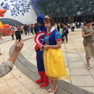 Performers show up at the Wanda City park dressed as Marvel's Captain America and Disney's Snow White.