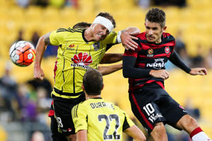 Ben Sigmund of the Phoenix defends against Dario Vidosic of the Wanderers during the round 27 A-League match between the Wellington Phoenix and Western Sydney Wanderers at Westpac Stadium on April 10, 2016 in Wellington, New Zealand