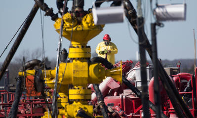 STILLWATER, OK - JANUARY 27: A Halliburton oil well fielder works on a well head at a fracking rig site January 27, 2016 near Stillwater, Oklahoma. (Photo by J Pat Carter/Getty Images)