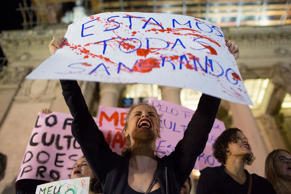 "File: A woman shouts holding a banner that reads in Portuguese ""We're all bleeding"" as she protests the gang rape of a 16-year-old girl in Rio de Janeiro, Brazil, Friday, May 27, 2016."