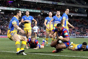 Pauli Pauli of the Knights scores a try during the round 12 NRL match between the Newcastle Knights and the Parramatta Eels at Hunter Stadium on May 30, 2016 in Newcastle, Australia