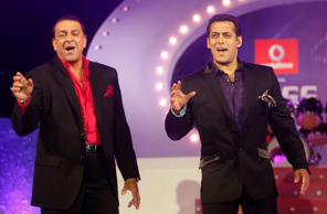 "Bollywood stars Sanjay Dutt, left, and Salman Khan perform during an event to announce the names of the 14 inmates of Bigg Boss 5, in Mumbai, India, Thursday, Sept 29, 2011. ""Bigg Boss"" is an Indian version of reality television show ""Big Brother."" It fe"