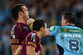 A file image of the infamous on-field throw of punches between Paul Gallen of the Blues and Nate Myles of the Maroons back in 2013.