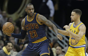 Cleveland Cavaliers' LeBron James, left, drives past Golden State Warriors' Stephen Curry in the second half of an NBA basketball game, Monday, Jan. 18, 2016, in Cleveland. The Warriors won 132-98.