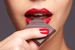 Closeup portrait of a cute young female biting into a piece of chocolate  Peopleimages/Getty Images