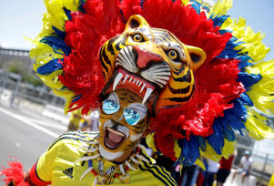A Colombia fan smiles before a Copa America Centenario Group A soccer match between the United States and Colombia at Levi's Stadium in Santa Clara, Calif., Friday, June 3, 2016. (AP Photo/Marcio Jose Sanchez)