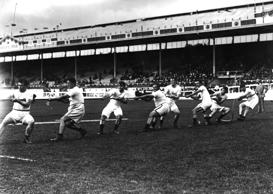 July 1908:  The Unites States tug-of-war team in action during the 1908 London O...