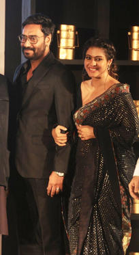 Slide 1 of 28: Actors Ajay Devgan and Kajol during the Mumbaikar Festival