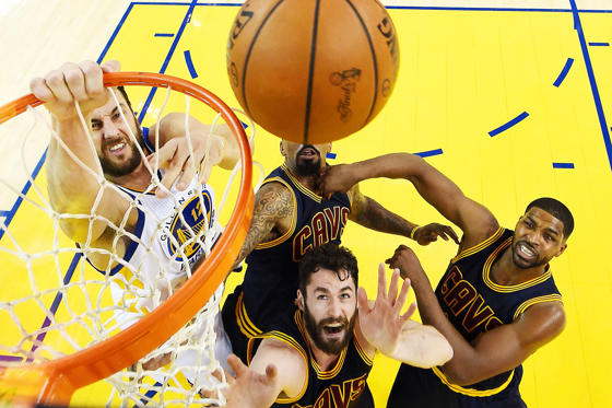 Golden State Warriors center Andrew Bogut (12) goes for a rebound against Cleveland Cavaliers forward Kevin Love (0) and Cleveland Cavaliers center Tristan Thompson (13) in game two of the NBA Finals at Oracle Arena on June 5.