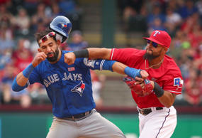 Toronto Blue Jays Jose Bautista (19) is punched by Texas Rangers second baseman Rougned Odor (12) after Bautista slid into second in the eighth inning of a baseball game at Globe Life Park in Arlington