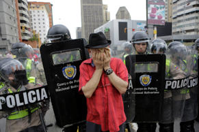Opposition supporters clash with riot policemen during a rally to demand a referendum to remove President Nicolas Maduro in Caracas, Venezuela, May 18, 2016.