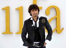 "File: Singer Sonu Nigam poses on the green carpet for ""IIFA Rocks"" during an International Indian Film Academy Awards event in Toronto June 24, 2011."
