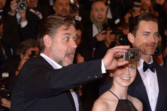 Slide 1 of 29: CANNES, FRANCE - MAY 15:  Actor Russell Crowe (L) takes a selfie with actress Angourie Rice (C) and actor Matt Bomer (R) at 'The Nice Guys' premiere during the 69th annual Cannes Film Festival at the Palais des Festivals on May 15, 2016 in Cannes, France