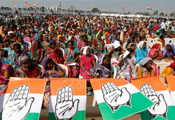 File: Supporters of India's ruling Congress party attend a rally being addressed by Rahul Gandhi, Congress party vice president and son of Congress chief Sonia Gandhi, ahead of the 2014 general elections at Bardoli in the western Indian state of Gujarat February 8, 2014.