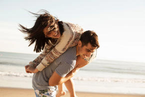 Young couple enjoying around on beach.