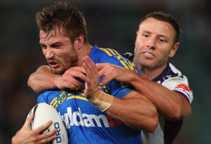 Kieran Foran of the Eels is tackled by Blake Green of the Storm during the round 11 NRL match between the Parramatta Eels and the Melbourne Storm at Pirtek Stadium on May 23, 2016 in Sydney, Australia