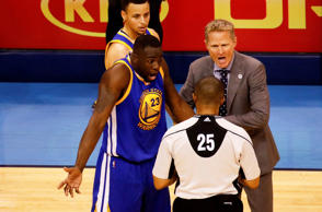 Draymond Green #23 and head coach Steve Kerr of the Golden State Warriors argue ...
