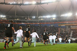The All Blacks run onto the field during a Rugby Championship match at Estadio Ciudad de La Plata.