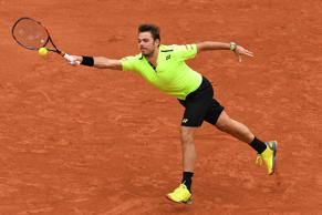 PARIS, FRANCE - MAY 23:  Stan Wawrinka of Switzerland hits a forehand during the Men's Singles first round match against Lukas Rosol of Czech Republic on day two of the 2016 French Open at Roland Garros on May 23, 2016 in Paris, France.  (Photo by Dennis