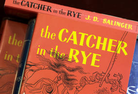 "This Jan. 28, 2010, file photo, shows copies of J.D. Salinger's classic novel ""The Catcher in the Rye"" at the Orange Public Library in Orange Village, Ohio."