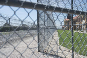 Fences and barbed wire at the entrance of the El Reno Federal Correctional Insti...