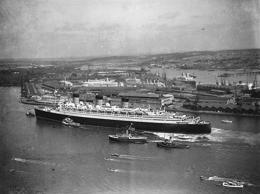 A tremendous reception greeted the British liner Queen Mary when it arrived in Southampton, England, on August 31, 1936, after her record breaking trip from New York.
