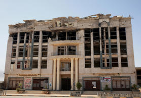 A building damaged during clashes between military forces loyal to Libya's eastern government and the Shura Council of Libyan Revolutionaries, an alliance of former anti-Gaddafi rebels who have joined forces with the Islamist group Ansar al-Sharia, is seen in Benghazi, Libya April 15, 2016.