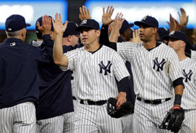 New York Yankees center fielder Jacoby Ellsbury (22) celebrates with teammates after defeating the Toronto Blue Jays at Yankee Stadium. The Yankees won 6-0.