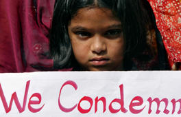File: A girl holds a placard as she takes part in a protest rally in the southern Indian city of Hyderabad December 29, 2012.