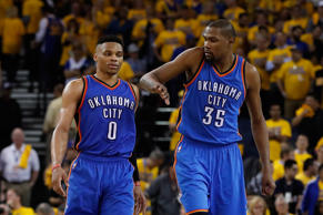 Kevin Durant #35 (R) of the Oklahoma City Thunder celebrates with Russell Westbrook #0 during the final moments of game one of the NBA Western Conference Finals against the Golden State Warriors at ORACLE Arena on May 16, 2016 in Oakland, California.