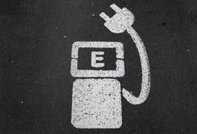 A battery charger sign for electric cars is painted on the ground of a parking ground near the soccer stadium in Wolfsburg, Germany, in this April 6, 2016 file photo.