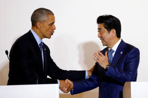 U.S. President Barack Obama shakes hands with Japan's Prime Minister Shinzo Abe during a press conference after a bilateral meeting during the 2016 Ise-Shima G7 Summit in Shima, Japan May 25, 2016.