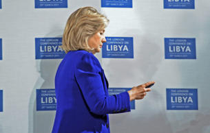 U.S. Secretary of State Hillary Clinton checks her phone at the opening of the L...