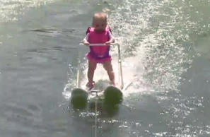 In this photo taken from a video made available by World Barefoot Center, 6-month-old Zyla St. Onge water-skis across Lake Silver in Winter Haven, Fla.