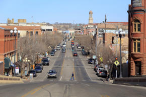A pedestrian crosses a street in downtown Pueblo, Colo., on Feb. 25, 2016.