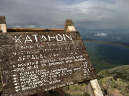 This Aug. 27, 2014 photo shows the weather-worn sign at the peak of Mount Katahd...