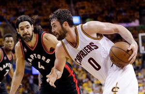 Cleveland Cavaliers' Kevin Love (0) drives on Toronto Raptors' Luis Scola (4) during the second half of Game 5 of the Eastern Conference finals Wednesday, May 25, 2016, in Cleveland.
