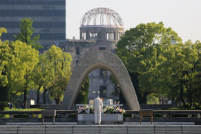 A man bows in front of the cenotaph, which is dedicated to the memory of the victim's of the atomic bomb, in Hiroshima, Japan, on Tuesday, May 17, 2016.