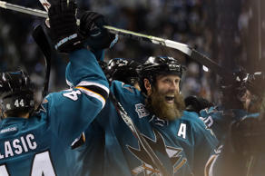 Joe Thornton #19 of the San Jose Sharks celebrates with Marc-Edouard Vlasic #44 of the San Jose Sharks after they beat the St. Louis Blues.
