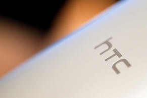 The HTC Corp. logo is imprinted on the back of the company's HTC J One HTL22 smartphone for KDDI Corp. during the unveiling event in Tokyo, Japan, on Monday, May 20, 2013.
