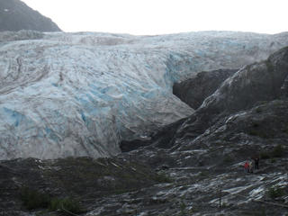 In this Aug. 4, 2012 file photo, tourists walk to Exit Glacier in Kenai Fjords National Park just outside Seward, Alaska. Global warming is carving measurable changes into the Alaskan Arctic.