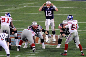 New England Patriots quarterback Tom Brady signals a play against the New York Giants in the 2008 Super Bowl.