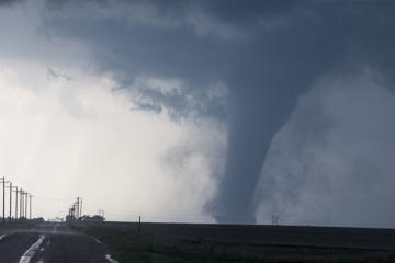A tornado is seen South of Dodge City, Kansas moving North on May 24, 2016 in Dodge City, Kansas. About 30 tornadoes were reported on Tuesday in five different states from Michigan to Texas. Damage to homes and property was also reported in Ford County, Kansas.