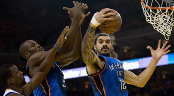 Oklahoma City Thunder center Steven Adams (12) reaches for a rebound against the Golden State Warriors during the second quarter in game five of the Western conference finals of the NBA Playoffs at Oracle Arena