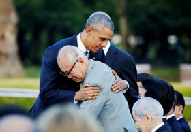 U.S. President Barack Obama (L) hugs with atomic bomb survivor Shigeaki Mori as he visits Hiroshima Peace Memorial Park on May 27, in Hiroshima, Japan.