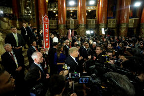 Donald Trump talks to reporters in the spin room after a debate on March 3 in Detroit.