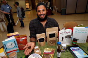 Anthony Hartinger, co-founder of Detroit Ento, a start-up turning locally sourced insects into food products, holds freeze-dried edible crickets in his hand during the 'Eating Insects Detroit: Exploring the Culture of Insects as Food and Feed' conference at Wayne State University in Detroit, Michigan May 26, 2016.